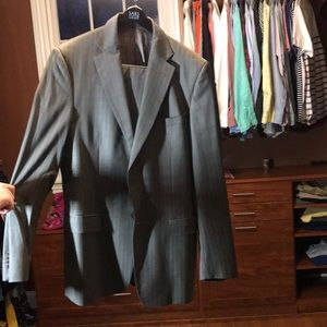 Versace suit and pants. Never worn